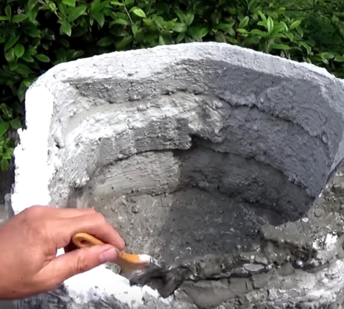 Make a cheap garden waterfall out of old styrofoam