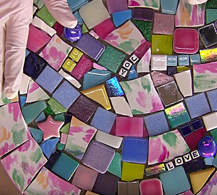Make a mosaic stepping stone from an old plate