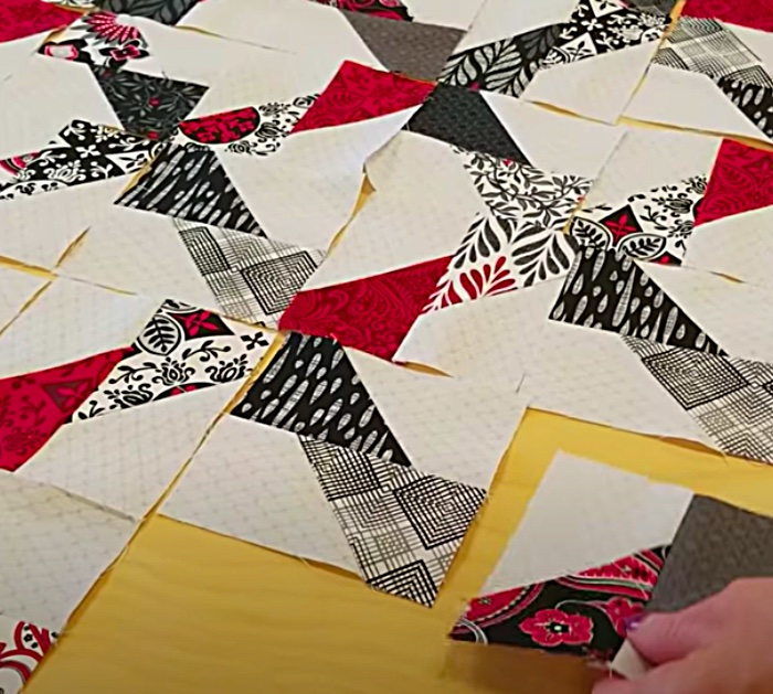 Make a jagged x quilt with a pack of layer cake fabric pieces