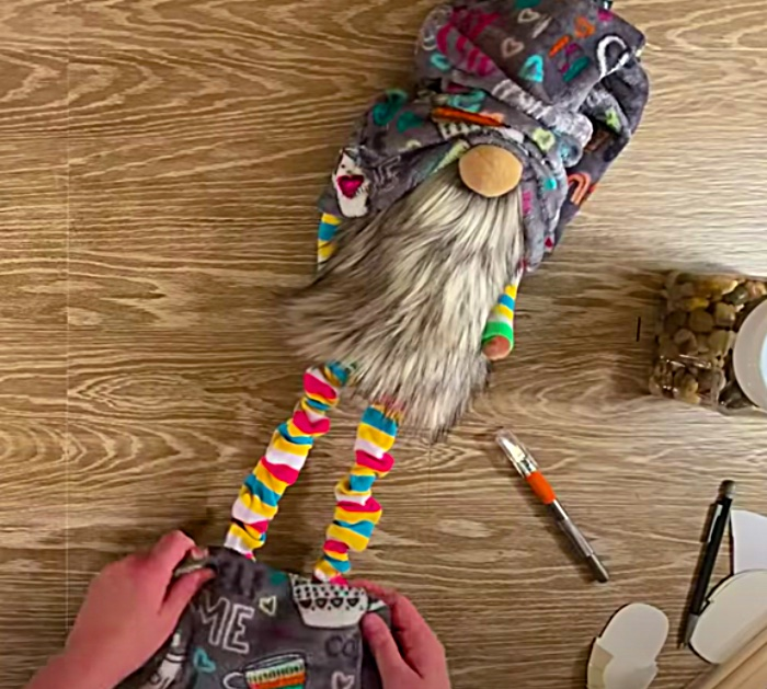 Make a long legged gnome out of felt with a beard