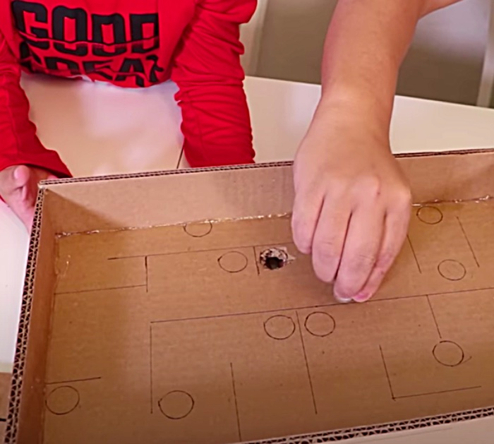 Make a cardboard maze game that is played with marbles.