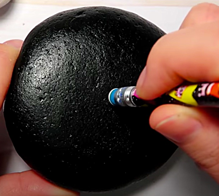 Make a mandala stone with craft paint