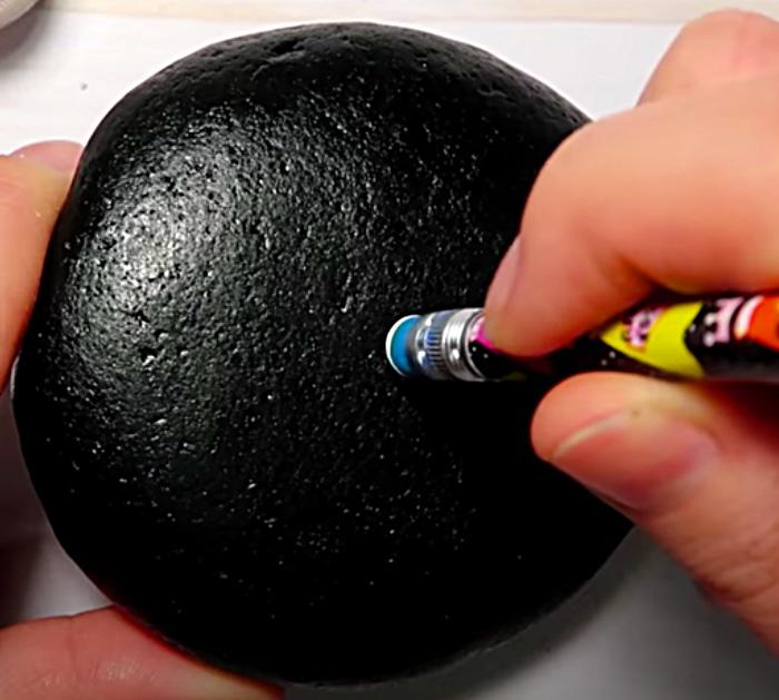 Make a mandala stone with craft paint