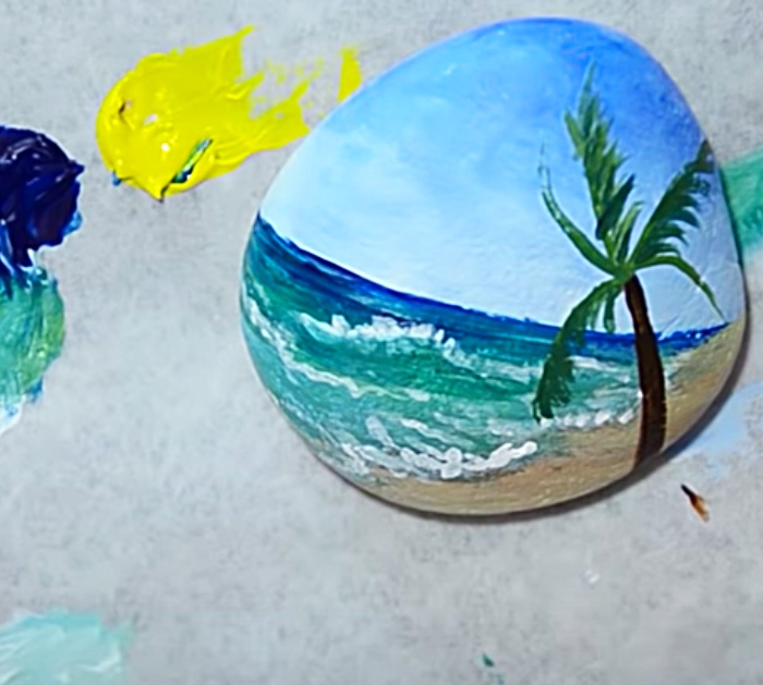 Small rock with hand painted beach scene
