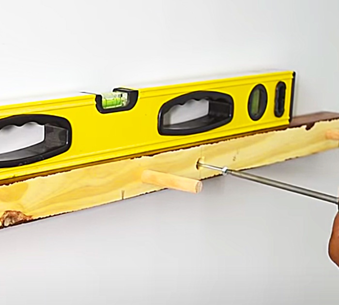Make a floating shelf from a 2 x 4 and dowel