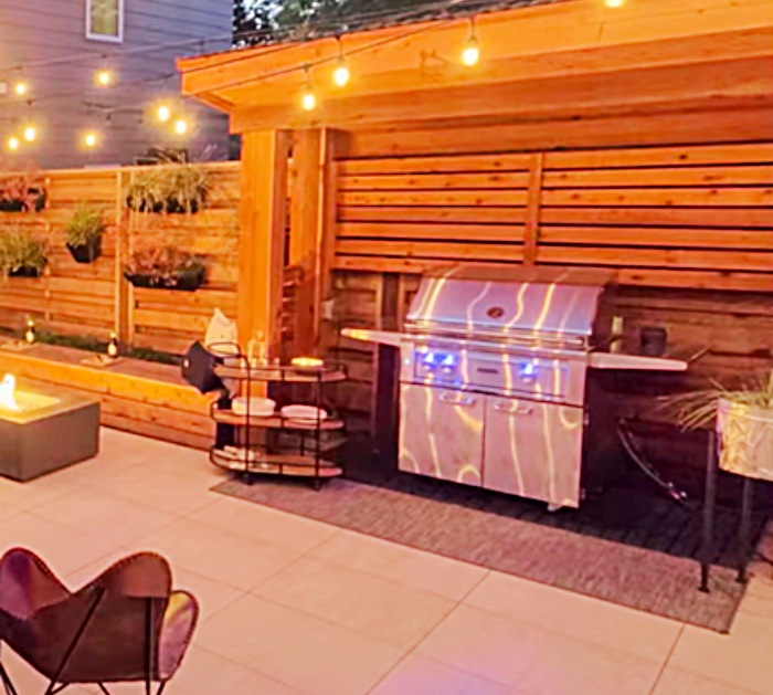 Make a privacy fence with a bar bq grotto