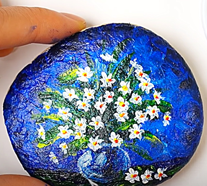 Paint river rocks with acrylic craft paints