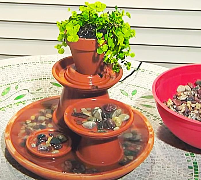 Terracotta pot DIY fountain with decorative rocks