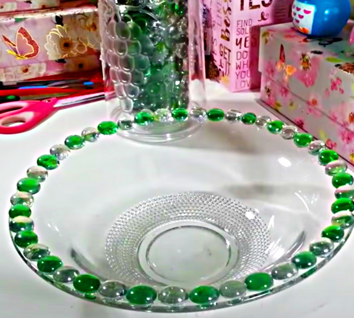 Make a birdbath from a bowl and a candle holder from the thrift store