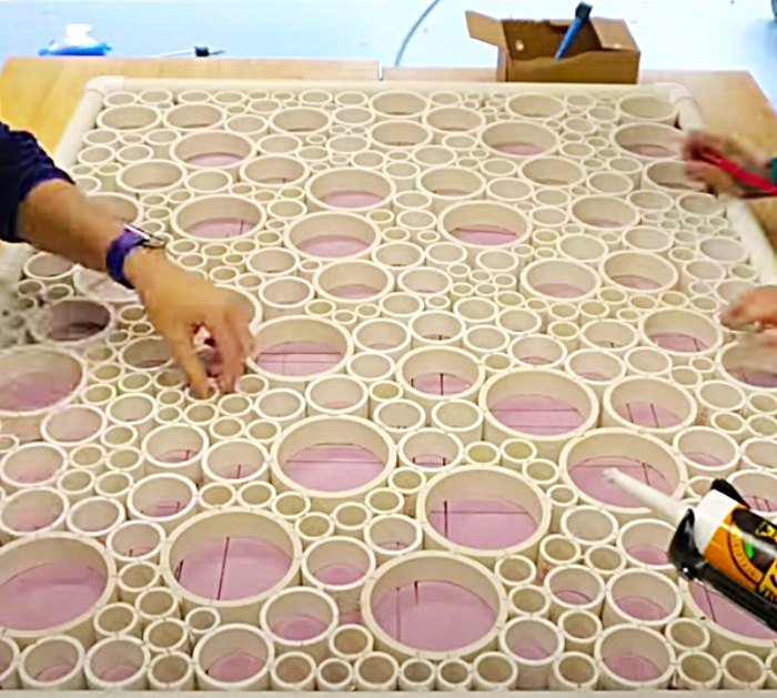 Glue PVC rings together to make a privacy screen