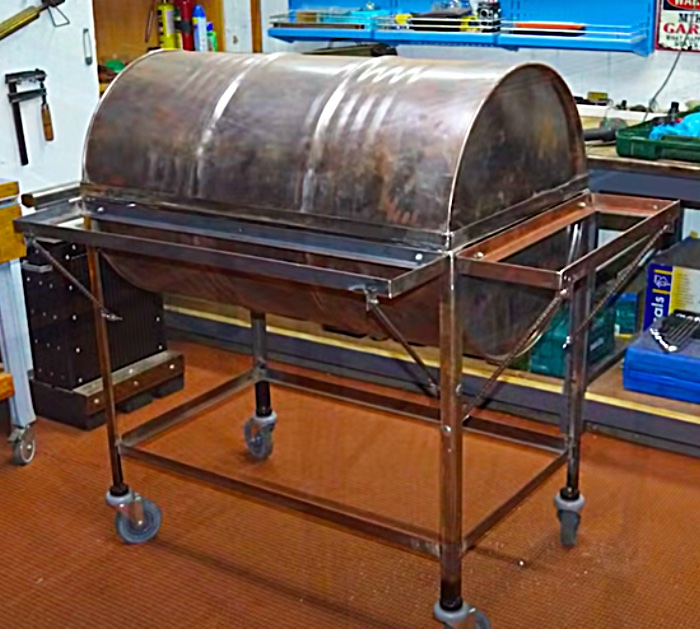 Set A Cut Metal Barrel Into A Metal Frame To Make A Standing Barbecue Pit With Castor Wheels