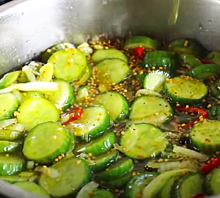 Homemade Bread And Butter Pickles With Onions And Red Peppers