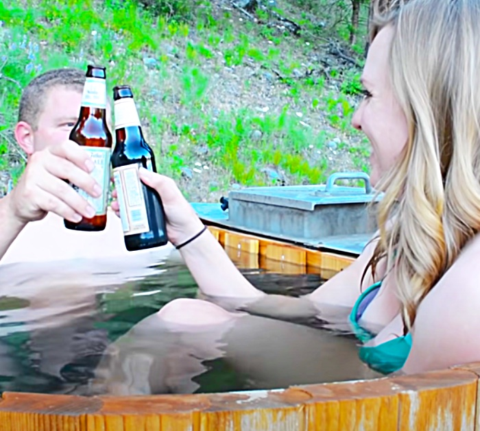 Relax And Soak In A Hot Tub With A Wood Burning Stove