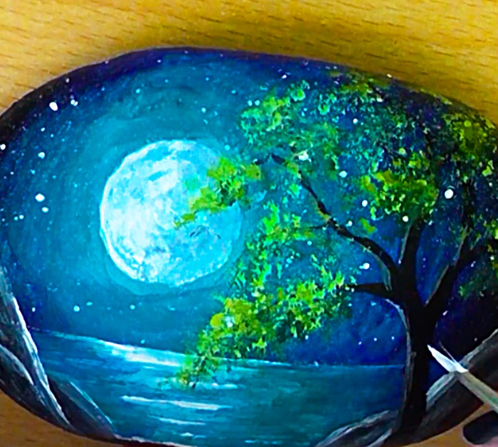 Use Craft Paint To Paint A Night Sky On A Rock
