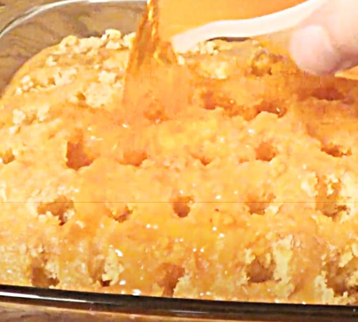 Poke Holes In A Cake To Pour Orange Jello To Make an Orange Creamsicle Poke Cake