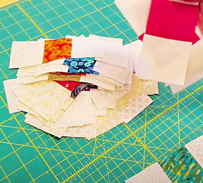 Cut Three Jelly Roll Strips Into Small Sections For A Scrappy Table Runner