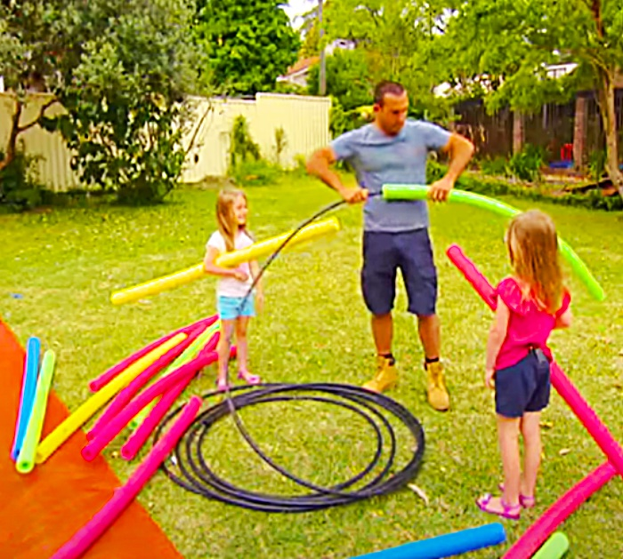 Build A Monster Slip And Slide with Pool Noodles And A Plastic Tarp