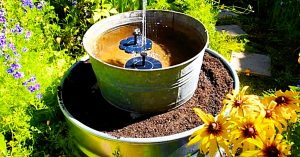 DIY Stock Tank Planter With A Solar Fountain