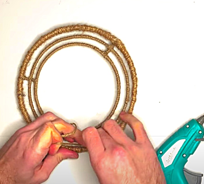 Wrap A Dollar Tree wreath Form With Jute To Make A Wood bead Chandelier