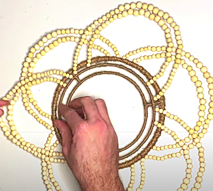 Attach Strands Of Beads With Copper Wire To A Dollar tree Wreath Form To make A Wood Bead Chandelier