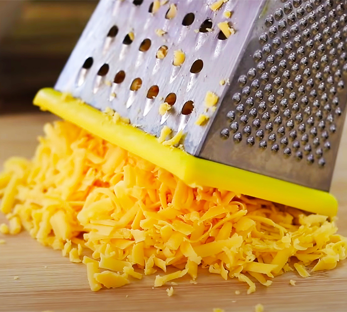 Grate Cheddar Cheese For Mac And Cheese - 3-Ingredient Recipes