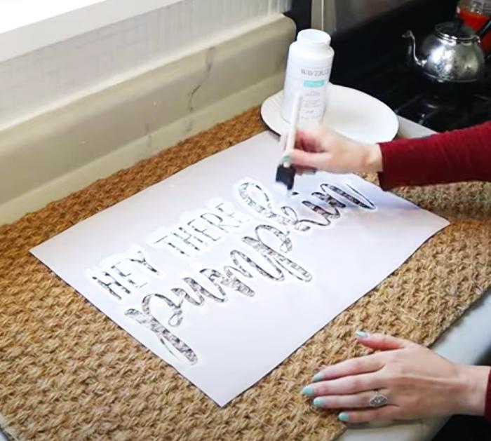 Use A Stencil to Paint Words On Door Mat - Pumpkin Door Mat