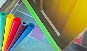 How To Fix A Drafty Door Using A Pool Noodle